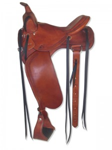 Chestnut Western Trail Saddle with butterfly skirts skirts Western rigging and a flank cinch, Frank Bell pommel with a horn, slick seat with a Cheyenne roll, wide fenders and border tooling.