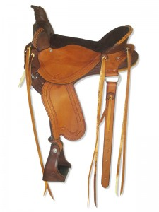 Hand dyed brown-saddle tan Lightweight Trail Saddle with cutback skirts and Western rigging with a flank cinch, Frank Bell pommel with a horn, extra padded seat with Mexican braided cantle, streamlined fenders and border tooling.