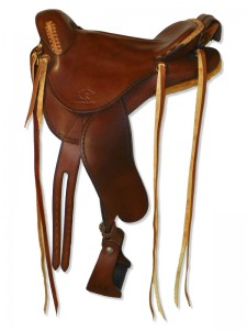 Brown Endurance Saddle with cutback skirts and bulkless English rigging, round pommel, slick seat with Mexican braided cantle, cavalry pouch, streamlined fenders and border tooling.