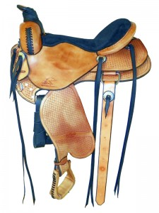 Russet Western Trail Saddle with full skirts, Western rigging with a flank cinch, wide pommel and a horn with a roper's wrap, extra padded seat with a Cheyenne roll, wide fenders and basket weave tooling.