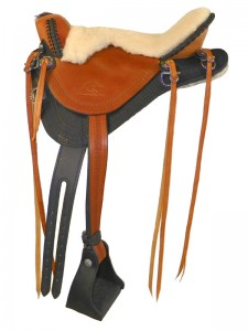 Black-Saddle Tan Endurance Saddle with cutback skirts and bulkless English rigging, round pommel, sheepskin seat with Mexican braided cantle, straps instead of fenders and border tooling.