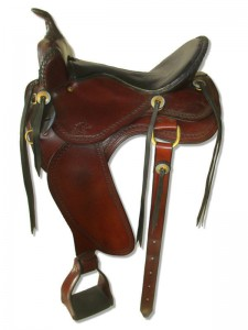 Hand dyed Mahogany Western Trail Saddle with butterfly skirts and Western rigging with a flank cinch, Frank Bell pommel with and a horn, extra padded seat with a Mexican braided cantle, wide fenders and border tooling.
