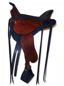 Hand dyed black-mahogany Lightweight Trail Saddle with cutback skirts and bulkless English rigging, round pommel with a horn, extra padded seat with Mexican braided cantle and streamlined fenders.