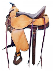 Brown-Russet Western Trail Saddle with butterfly skirts with Western rigging and a flank cinch, Frank Bell pommel with a horn, extra padded seat with Mexican braided cantle, wide fenders and border tooling.