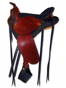 Black-mahogany hand dyed lightweight trail saddle with round pommel and a horn, extra padded seat cutback skirts and border tooling.