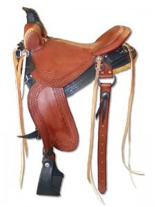 Black Chestnut Western Trail Saddle with cutback skirts, Frank Bell Pommel with a horn slick seat with a Cheyenne Roll wide fenders and border tooling